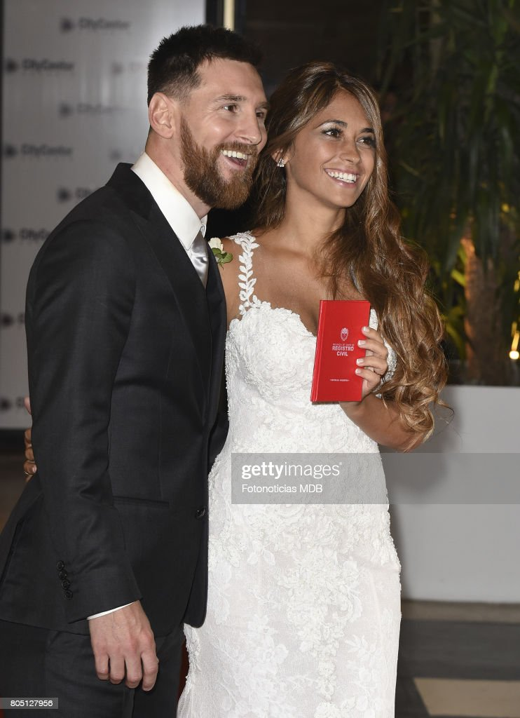 Lionel messi and antonella rocuzzos wedding photos and images lionel messi and antonela roccuzzo greet the press after their civil wedding ceremony at the city junglespirit Gallery