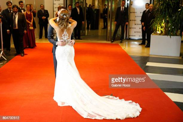 Lionel Messi and Antonela Rocuzzo kiss on the red carpet during Lionel Messi and Antonela Rocuzzo's Wedding at City Center Hotel on June 30 2017 in...