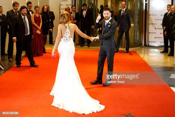 Lionel Messi and Antonela Rocuzzo pose for pictures on the red carpet during Lionel Messi and Antonela Rocuzzo's Wedding at City Center Hotel on June...