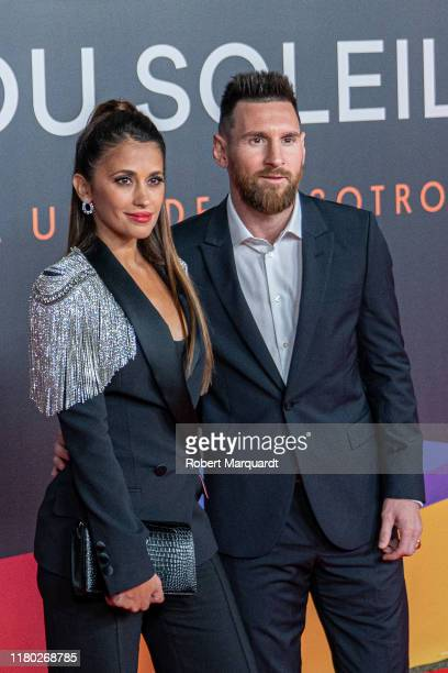 Lionel Messi and Antonella Rocuzzo pose on the red carpet for the premiere of Messi10 by Cirque Du Soleil on October 10 2019 in Barcelona Spain