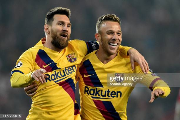 Lionel Messi and Arthur of Barcelona celebrate their goal during the UEFA Champions League Group F soccer match between SK Slavia Praha and FC...