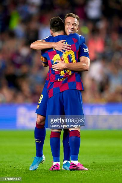 Lionel Messi and Arthur of FC Barcelona celebrating their team's second goal during the Liga match between FC Barcelona and Villarreal CF at Camp Nou...