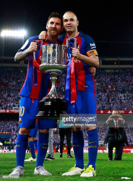 Lionel Messi and captain Andres Iniesta of FC Barcelona pose for a picture with the King's Cup after winning the Copa Del Rey Final between FC...