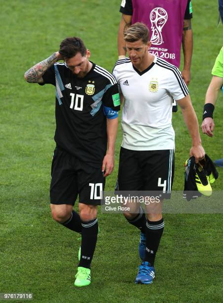 Lionel Messi and Cristian Ansaldi of Argentina leave the pitch following the 2018 FIFA World Cup Russia group D match between Argentina and Iceland...