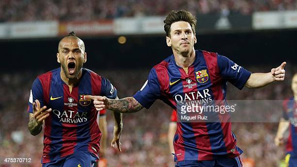 Lionel Messi and Dani Alves of FC Barcelona celebrates after scoring the first goal during the Copa del Rey Final between Athletic Club and FC...