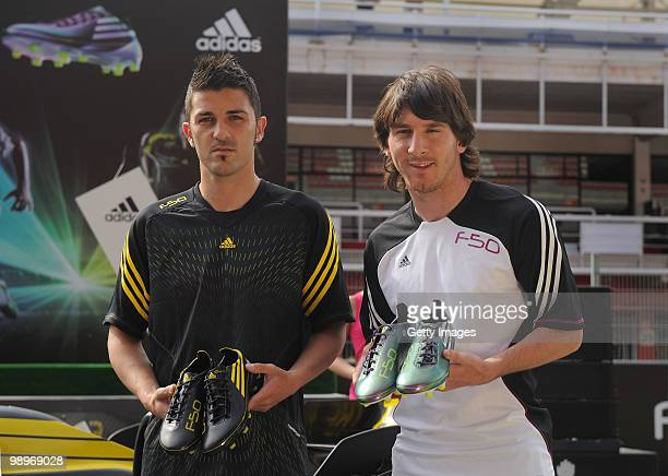 Lionel Messi and David Villa present the adidas F50 adiZero the lightest ever football boot during the launch at the Circuit de Catalunya on May 11...