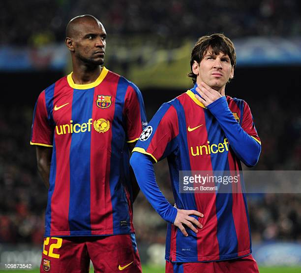 Lionel Messi and Eric Abidal of Barcelona wait for kickoff before the UEFA Champions League round of 16 second leg match between Barcelona and...
