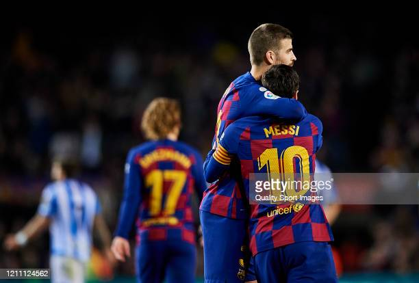Lionel Messi and Gerard Pique of FC Barcelona during the Liga match between FC Barcelona and Real Sociedad at Camp Nou on March 07 2020 in Barcelona...