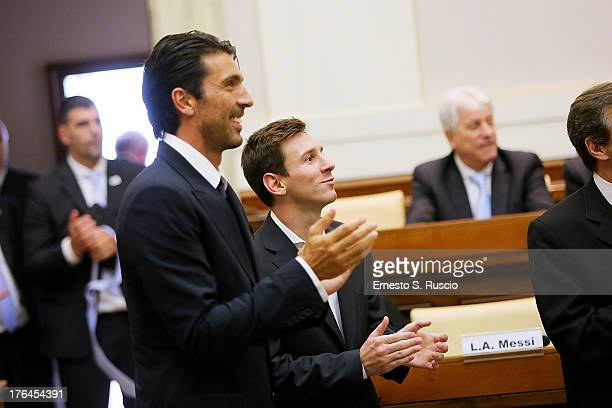 Lionel Messi and Gianluigi Buffon attend the press confernce of Italy and Argentina Football Teams at The Vatican on August 13 2013 in Vatican City...