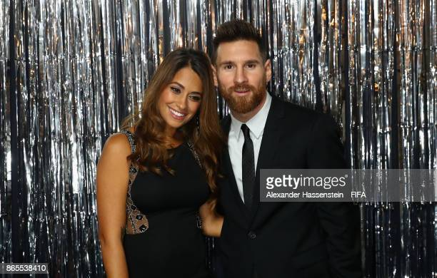 Lionel Messi and his wife Antonella Roccuzzo are pictured inside the photo booth prior to The Best FIFA Football Awards at The London Palladium on...
