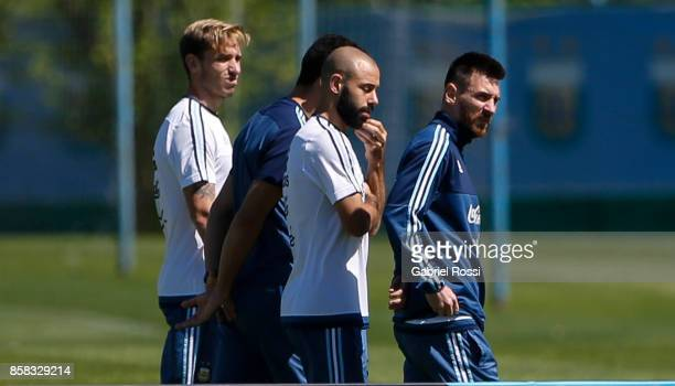 Lionel Messi and Javier Mascherano of Argentina talk during a training session at Argentine Football Association 'Julio Humberto Grondona' training...