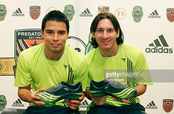 Lionel Messi and Javier Saviola present the new Adidas F50 boots at the Adidas Barcelona store on February 12 2007 in Barcelona Spain
