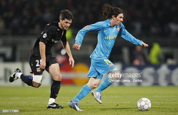 Lionel Messi and Jeremy Toulalan during the champions league soccer match between Olympique Lyonnais and FC Barcelona