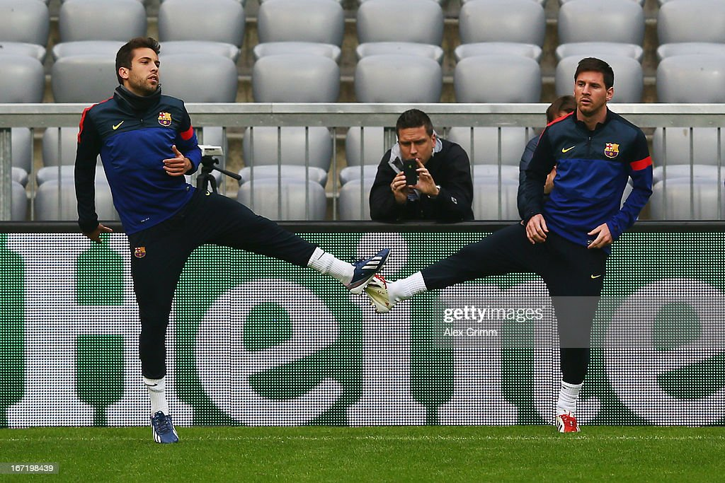 Lionel Messi (R) and Jordi Alba exercise during a FC Barcelona press conference ahead of their UEFA Champions League Semi Final first leg match against FC Bayern Muenchen on April 22, 2013 in Munich, Germany.