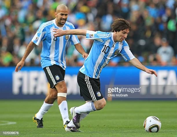 Lionel Messi and Juan Veron of Argentina in action during the 2010 FIFA World Cup South Africa Group B match between Argentina and Nigeria at Ellis...