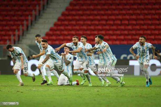 Lionel Messi and Lautaro Martinez of Argentina celebrate with teammates winning a penalty shootout after a semi-final match of Copa America Brazil...