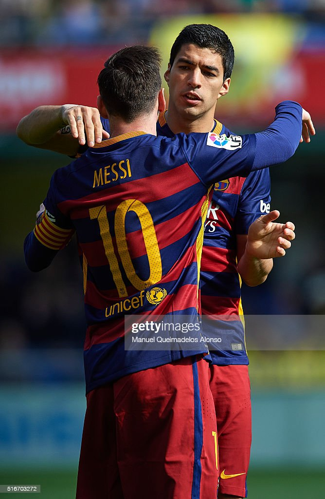 Lionel Messi and Luis Suarez of Barcelona celebrate during the La Liga match between Villarreal CF and FC Barcelona at El Madrigal on March 20, 2016 in Villarreal, Spain.
