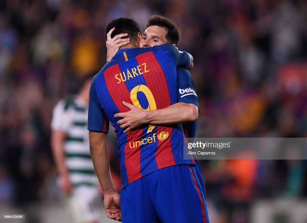 Lionel Messi and Luis Suarez of Barcelona share a hug during the La Liga match between Barcelona and Eibar at Camp Nou on 21 May, 2017 in Barcelona, Spain.