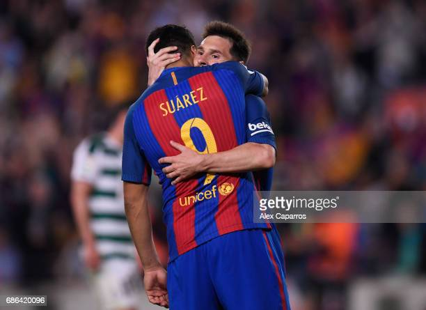 Lionel Messi and Luis Suarez of Barcelona share a hug during the La Liga match between Barcelona and Eibar at Camp Nou on 21 May 2017 in Barcelona...