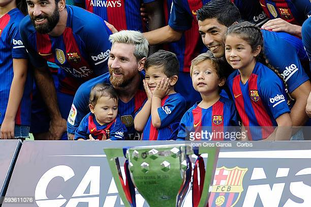 Lionel Messi and Luis Suarez of FCBarcelona posing with their children before the Spanish League match between FC Barcelona vs Real Betis Balompié at...