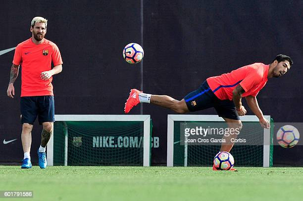 Lionel Messi and Luis Suárez playing with the ball during the training session at the Sports Center FC Barcelona Joan Gamper before the Spanish...