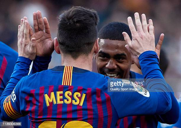 Lionel Messi and Malcom of FC Barcelona celebrates their team's second goal during the La Liga match between FC Barcelona and RCD Espanyol at Camp...