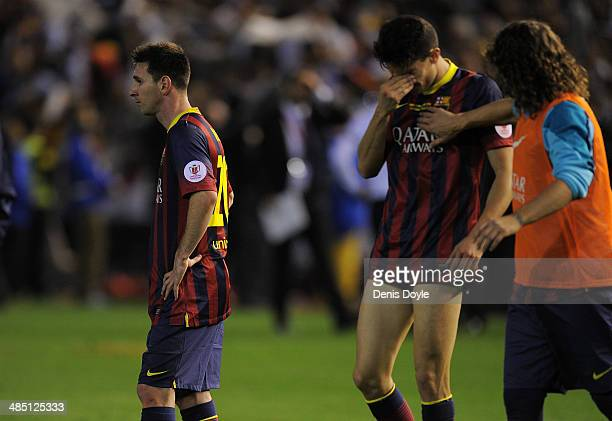 Lionel Messi and Marc Bartra of FC Barcelona react after losing 21 to Real Madrid in the Copa del Rey Final between Real Madrid and Barcelona at...