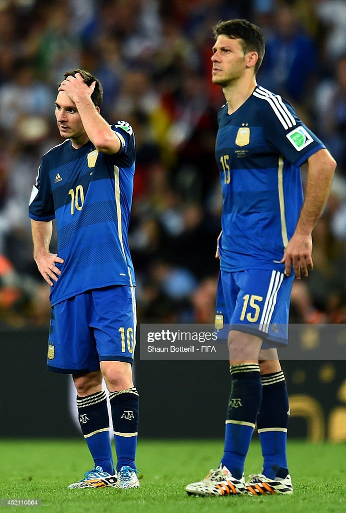 Lionel Messi (L) and Martin Demichelis (R) of Argentina react after the 0-1 defeat in the 2014 FIFA World Cup Brazil Final match between Germany and Argentina at Maracana on July 13, 2014 in Rio de Janeiro, Brazil.