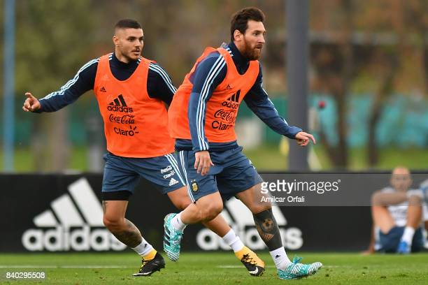 Lionel Messi and Mauro Icardi of Argentina look on during a training session at 'Julio Humberto Grondona' training camp on August 28 2017 in Ezeiza...