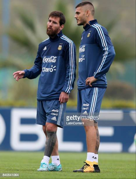 Lionel Messi and Mauro Icardi talk during a training session at 'Julio Humberto Grondona' training camp on August 29 2017 in Ezeiza Argentina