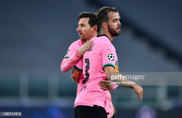 Lionel Messi and Miralem Pjanic of Barcelona celebrate after the UEFA Champions League Group G stage match between Juventus and FC Barcelona at...