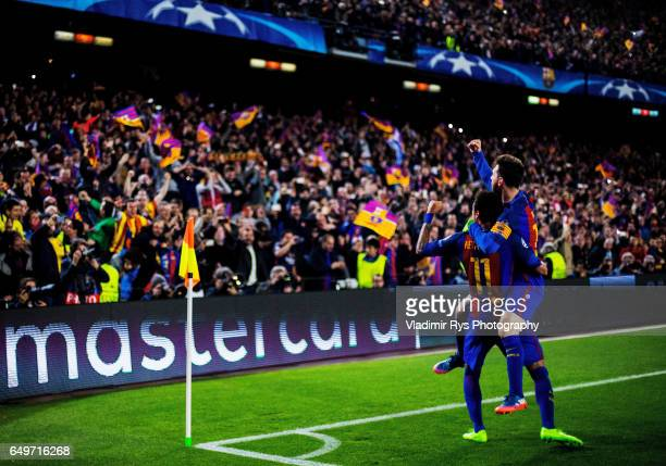 Lionel Messi and Neymar Jr of Barcelona celebrate after the 61 goal scored by their team mate Sergi Roberto during the UEFA Champions League Round of...