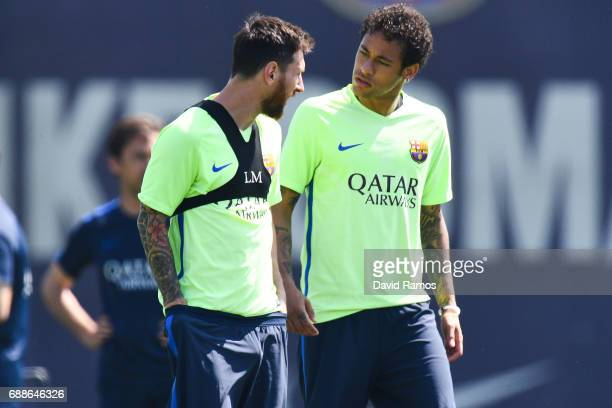 Lionel Messi and Neymar Jr of FC Barcelona chat during a training session at FC Barcelona Sports Centre on May 26 2017 in Barcelona Spain