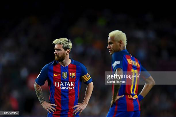 Lionel Messi and Neymar Jr of FC Barcelona look on during the La Liga match between FC Barcelona and Deportivo Alaves at Camp Nou stadium on...