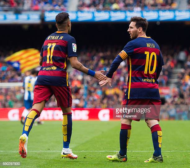 Lionel Messi and Neymar Santos Jr of FC Barcelona clashes their hands during the La Liga match between FC Barcelona and RCD Espanyol at Camp Nou on...