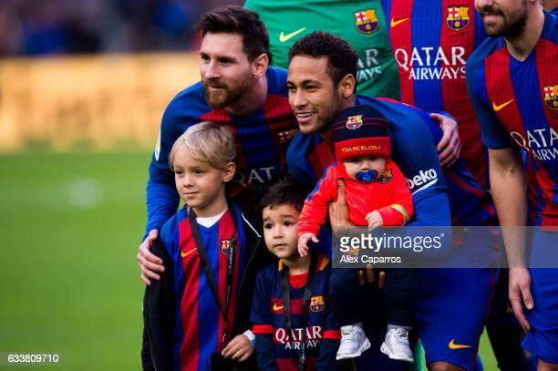 Lionel Messi and Neymar Santos Jr of FC Barcelona pose with son of Neymar Santos Jr Davi Lucca da Silva Santos and other childrens before the La Liga...