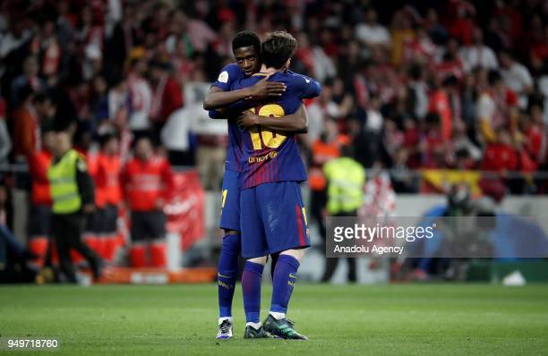 Lionel Messi and Ousmane Dembele gesture after Copa del Rey Final soccer match between Sevilla and Barcelona at Wanda Metropolitano Stadium in Madrid...