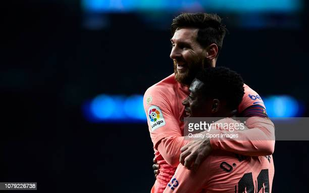 Lionel Messi and Ousmane Dembele of FC Barcelona celebrates the second goal during the La Liga match between RCD Espanyol and FC Barcelona at RCDE...