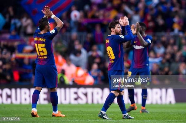 Lionel Messi and Paulinho of FC Barcelona celebrate victory after the La Liga match between Barcelona and Atletico Madrid at Camp Nou on March 4 2018...
