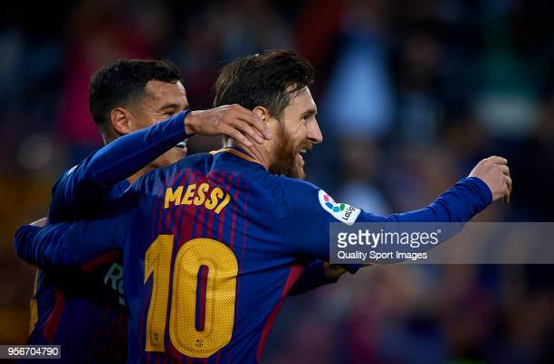 Lionel Messi and Philippe Coutinho of Barcelona celebrates a goal during the La Liga match between Barcelona and Villarreal at Camp Nou on May 9 2018...