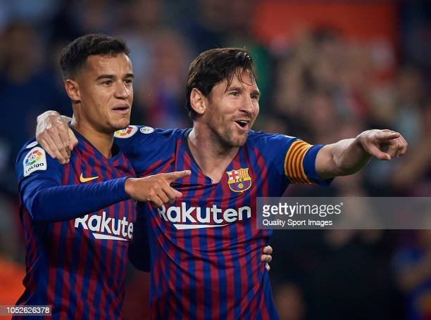 Lionel Messi and Philippe Coutinho of Barcelona celebrates the second goal during the La Liga match between FC Barcelona and Sevilla FC at Camp Nou...