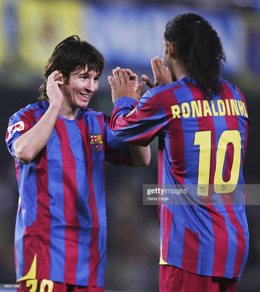 Lionel Messi (L) and Ronaldinho of Barcelona celebrate after beating Villarreal 2-0 during the Primera Liga match between Villarreal and F.C. Barcelona on December 4 2005 at the Madrigal stadium in Villarreal, Spain.