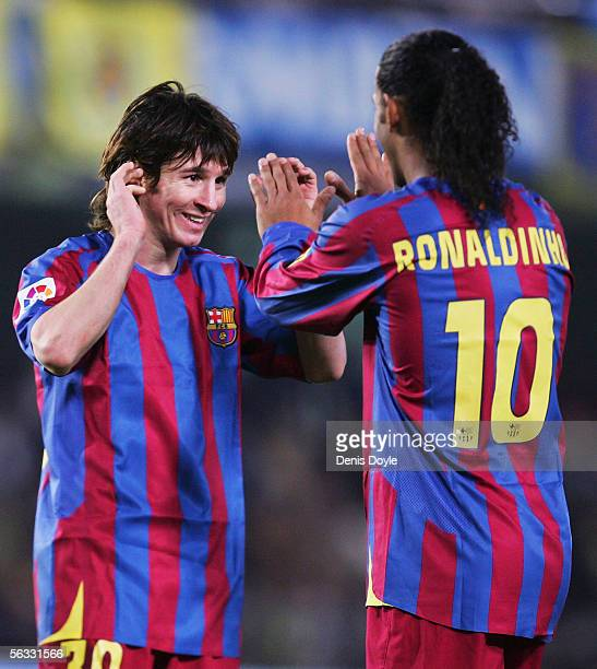 Lionel Messi and Ronaldinho of Barcelona celebrate after beating Villarreal 20 during the Primera Liga match between Villarreal and FC Barcelona on...