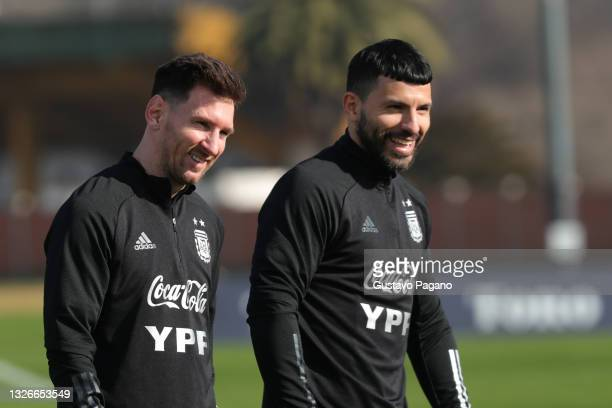 Lionel Messi and Sergio Agüero of Argentina smile during a training session at Julio Humberto Grondona training camp on July 02, 2021 in Ezeiza,...