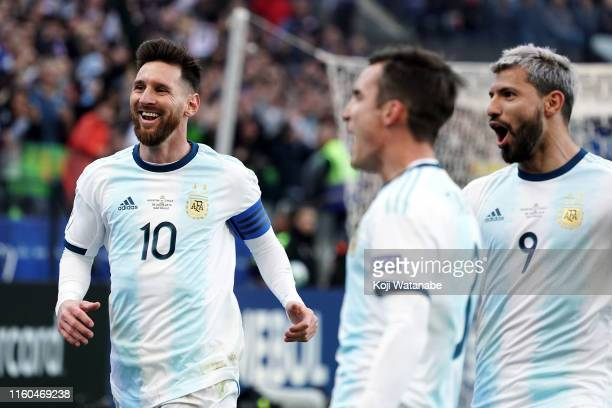 Lionel Messi and Sergio Aguero celebrate the second goal of their team scored by teammate Paulo Dybala during the Copa America Brazil 2019 Third...