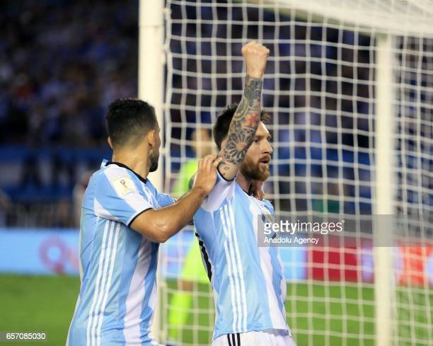 Lionel Messi and Sergio Aguero of Argentina celebrate scoring a goal during the FIFA 2018 World Cup Qualifiers football match between Argentina and...