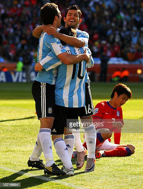 Lionel Messi and Sergio Aguero of Argentina celebrate the second goal by Gonzalo Higuain of Argentina during the 2010 FIFA World Cup South Africa...