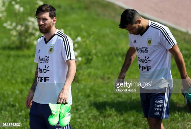 Lionel Messi and Sergio Aguero of Argentina look on prior a training session at Stadium of Syroyezhkin sports school on June 19 2018 in Bronnitsy...