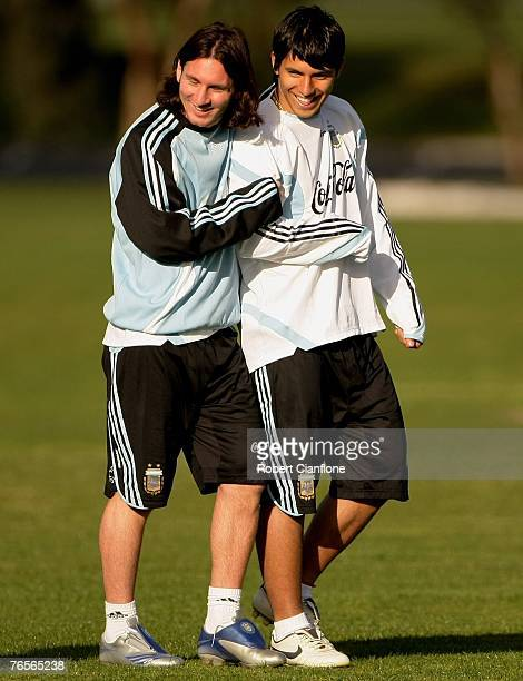 Lionel Messi and Sergio Aguero of Argentina share a joke during an Argentina training session held at Trinity GrammarSeptember 7 2007 in Melbourne...