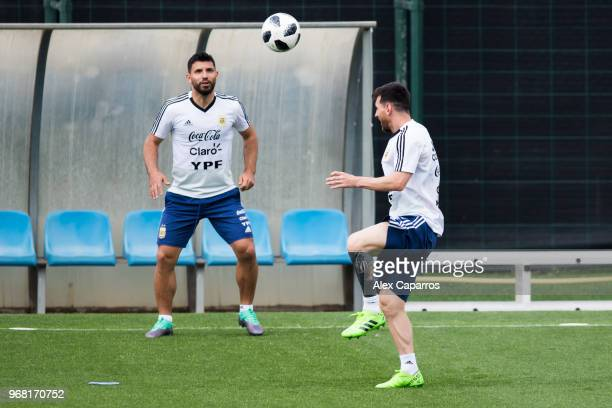 Lionel Messi and Sergio Aguero of Argentina take part in a training session as part of the team preparation for FIFA World Cup Russia 2018 at FC...